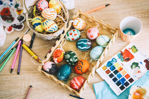 Happy Easter! Painting eggs. Paints, felt-tip pens, decorations for coloring eggs for holiday. Creative background. stock photo