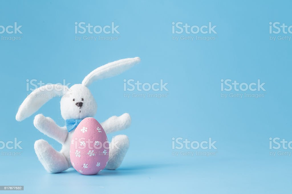 Happy Easter - Toy rabbit and easter eggs stock photo