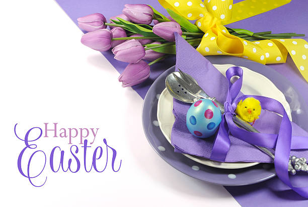 happy easter yellow and purple table place setting with text - easter brunch stock photos and pictures