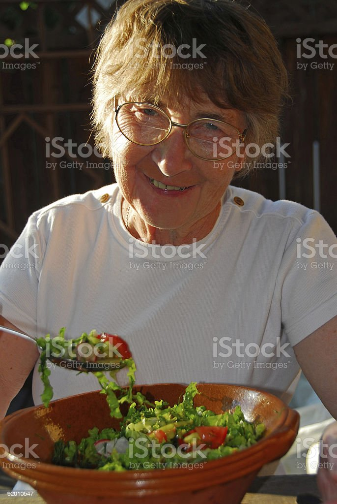 Happy eating senior woman royalty-free stock photo