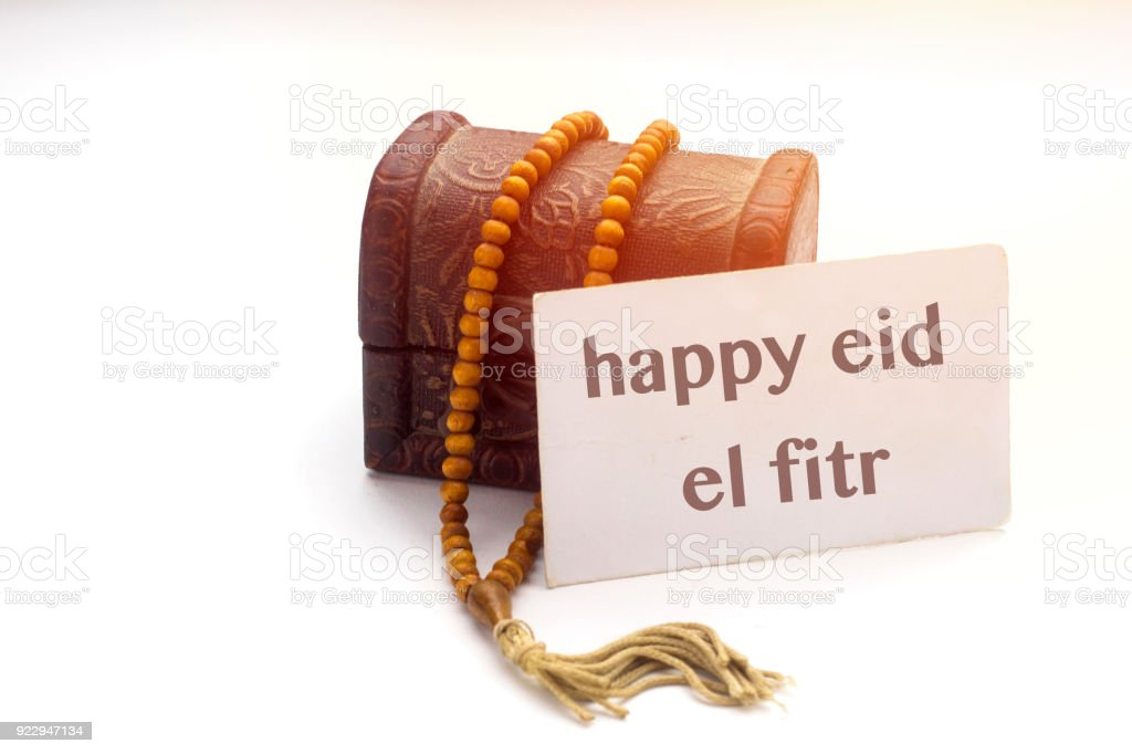 Simple Algeria Eid Al-Fitr Decorations - happy-eid-el-fitr-text-on-white-card-and-brown-rosary-muslim-with-picture-id922947134  Picture_547590 .com/photos/happy-eid-el-fitr-text-on-white-card-and-brown-rosary-muslim-with-picture-id922947134