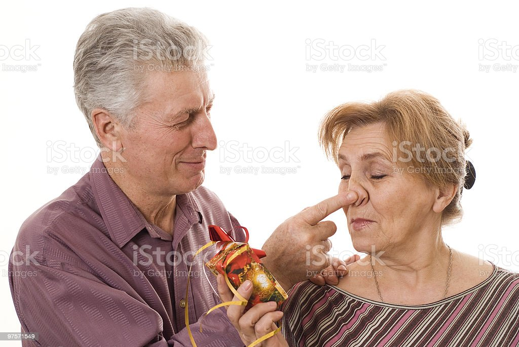 happy elderly couple with a gift royalty-free stock photo