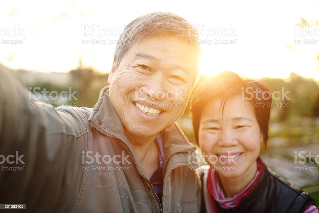 Happy elderly seniors couple selfie stock photo