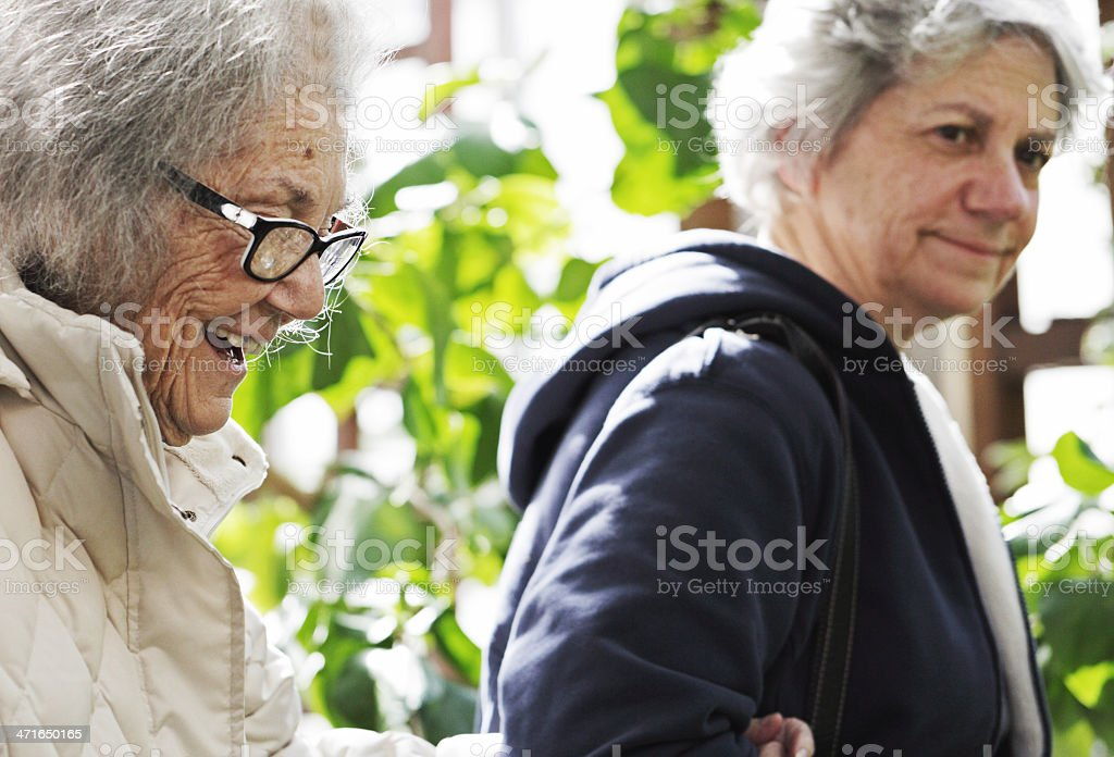 Happy Elderly Woman At Garden Exhibit royalty-free stock photo