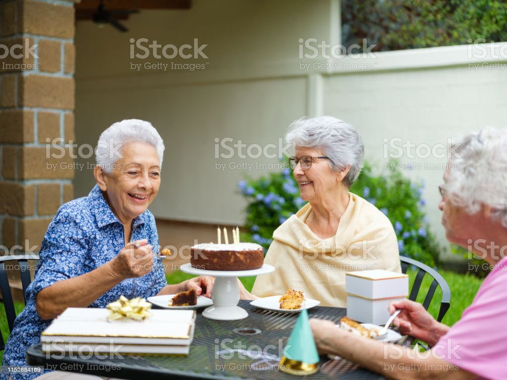 Incredible Happy Elderly Women Eating Birthday Cake Together Outside Stock Funny Birthday Cards Online Hendilapandamsfinfo