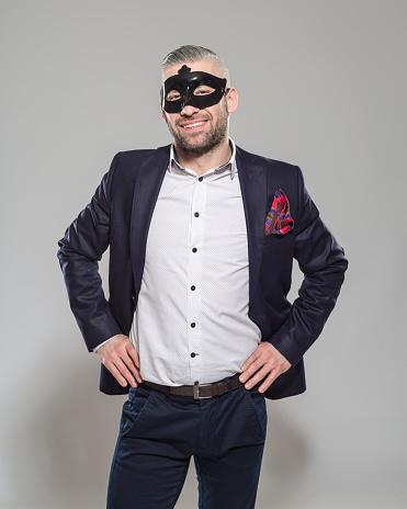 Happy Elegant Bearded Man Wearing Carnival Mask Stock Photo - Download Image Now
