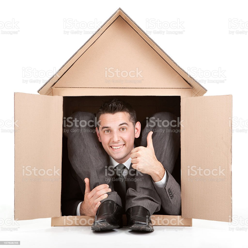 happy elegant flexible contortion business man cardboard house thumb up royalty-free stock photo