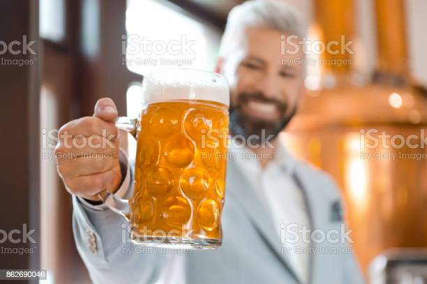 Happy Elegant Man Holding A Beer Mug In Microbrewery Stock Photo - Download Image Now