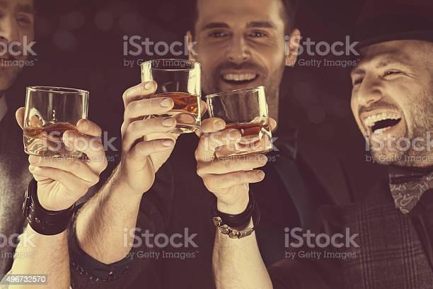 Happy elegant men toasting with whiskey picture id496732570?b=1&k=6&m=496732570&s=612x612&h=rabelr qoogan0olti2th1wi6envkjr7hv40m kg8n4=