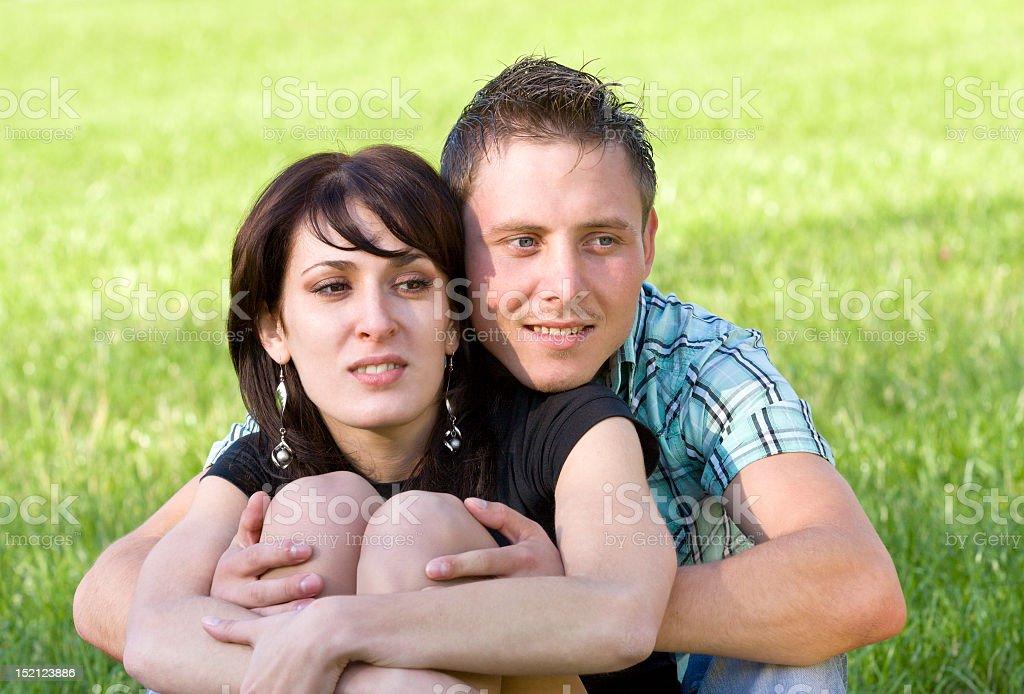 Happy embracing couple portraits stock photo