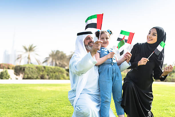 happy emirate family celebrate the national day - uae national day 뉴스 사진 이미지