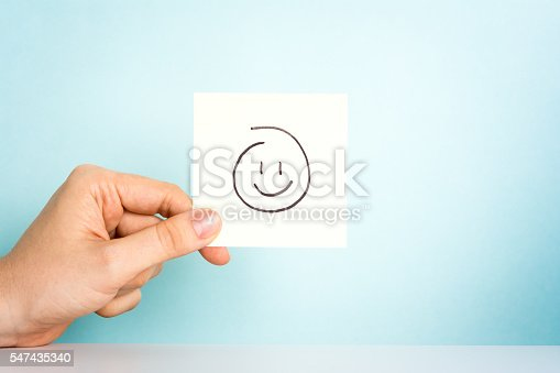 istock Happy employee. Happy emoticon or icon on blue background. 547435340
