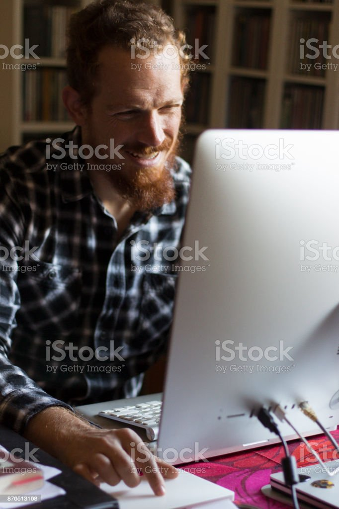 Happy Employee laughing at work in office stock photo