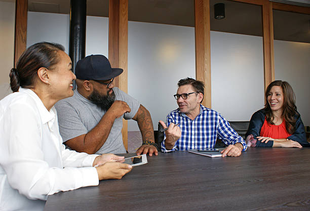 Happy employees in a meeting stock photo