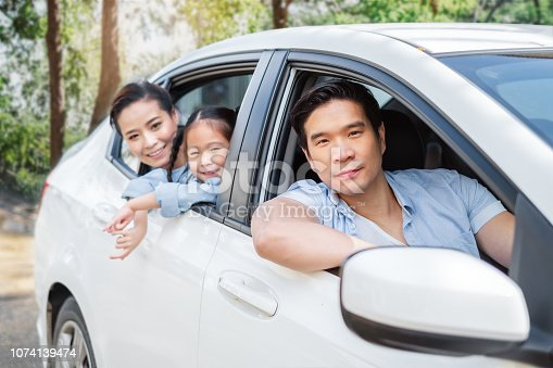 972962180 istock photo Happy enjoy Asian family in car driving to travel in weekend 1074139474