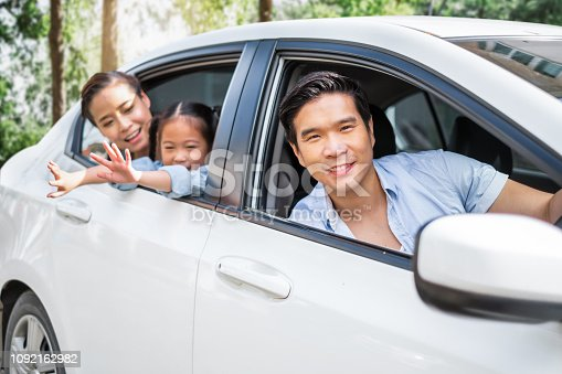972962180 istock photo Happy enjoy Asian family in car driving to travel in weekend 1092162982