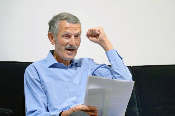 Happy entrepreneur elderly man reading good news in a letter on sofa picture id1085107966?b=1&k=6&m=1085107966&s=612x612&w=0&h=o4i3lfkxbgr9ycddsulsybm8gm9i39hnd ttieihrda=