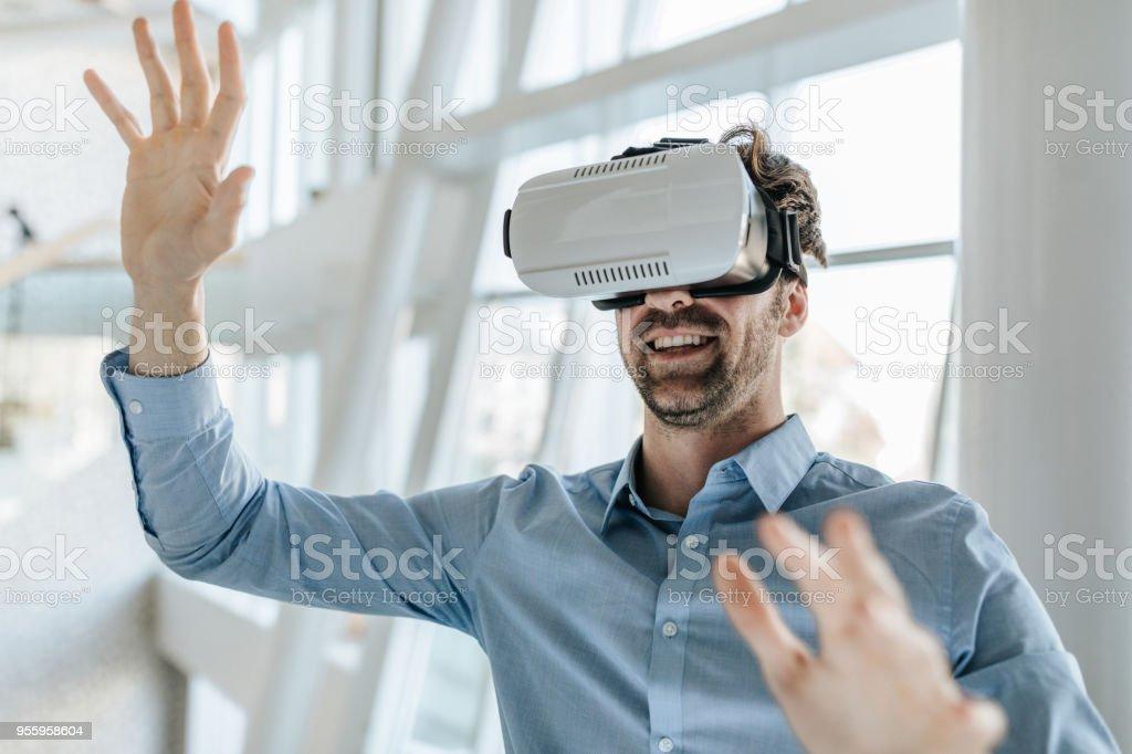ee87391defb Happy entrepreneur having fun while using virtual reality simulator. royalty-free  stock photo