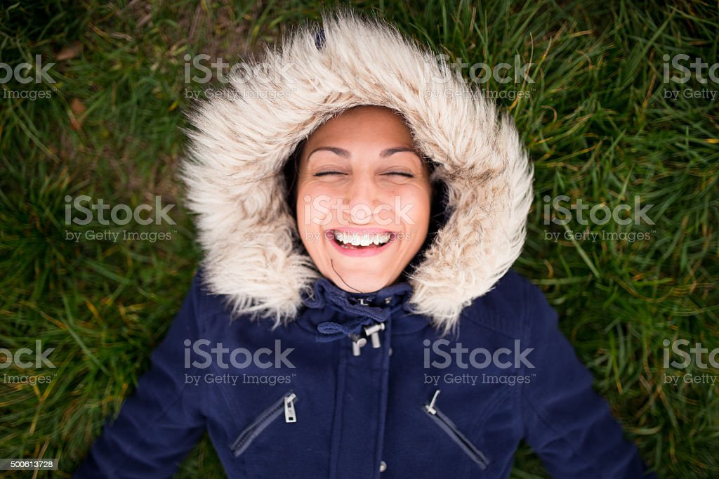 Happy eskimo girl on the ground,laughing stock photo