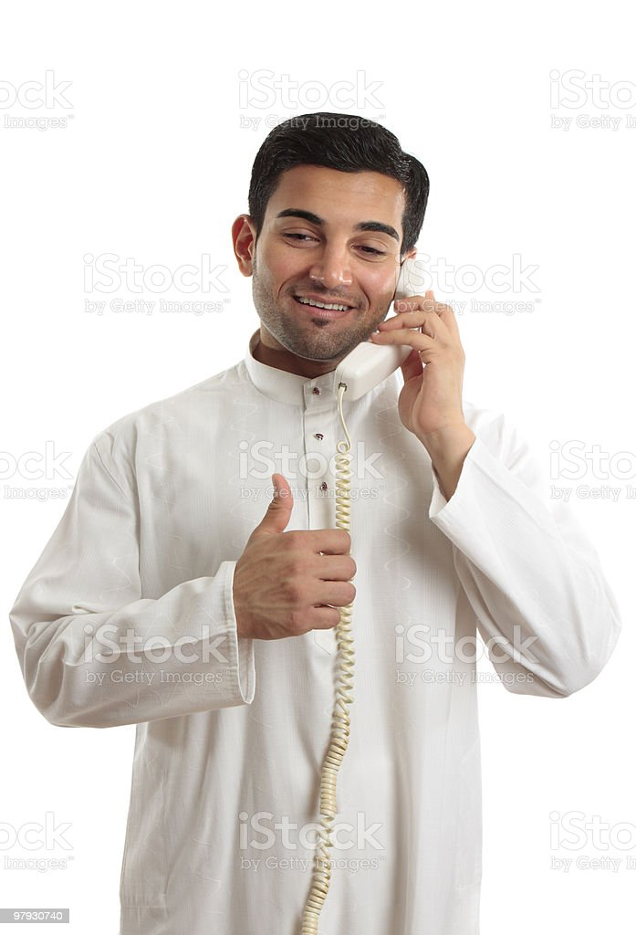 Happy ethnic businessman on phone royalty-free stock photo