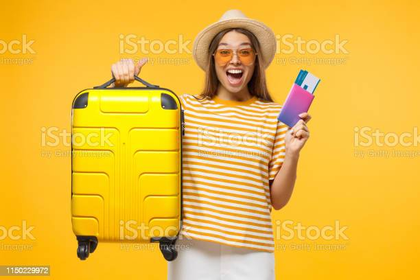 Happy european girl with suitcase and airplane tickets isolated on picture id1150229972?b=1&k=6&m=1150229972&s=612x612&h=uada6x8lm6jin5rqopqtlme60dm3lvgbldzkao ewic=