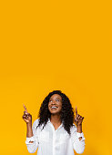 istock Happy excited african american man pointing at empty space 1159989026