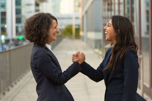Happy excited colleagues celebrating triumph together stock photo