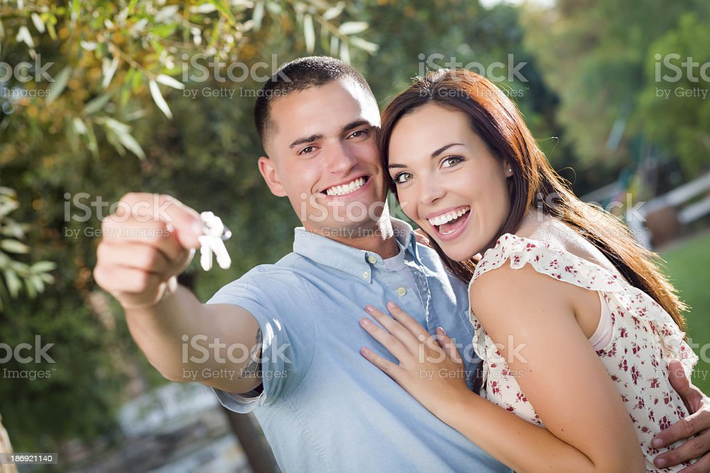 Happy Excited Couple with New House Keys stock photo