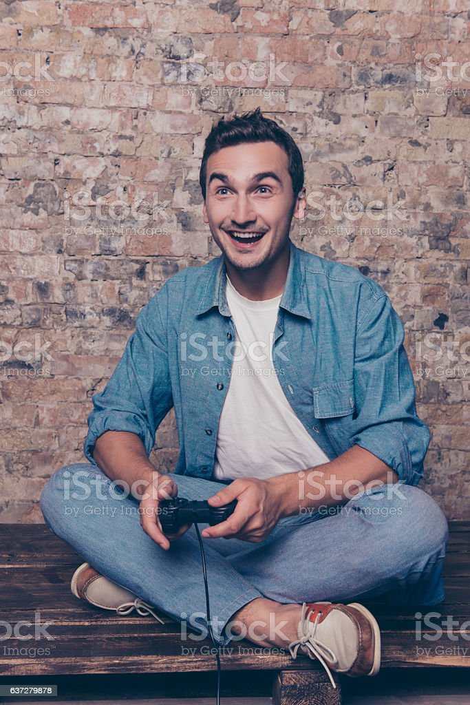 Happy excited handsome man playing video game stock photo