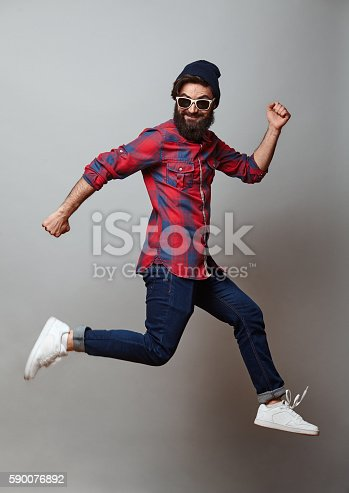 istock happy excited jmping young bearded man 590076892