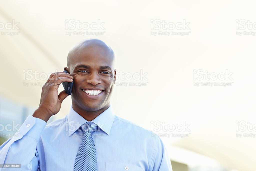Happy executive on mobile phone royalty-free stock photo