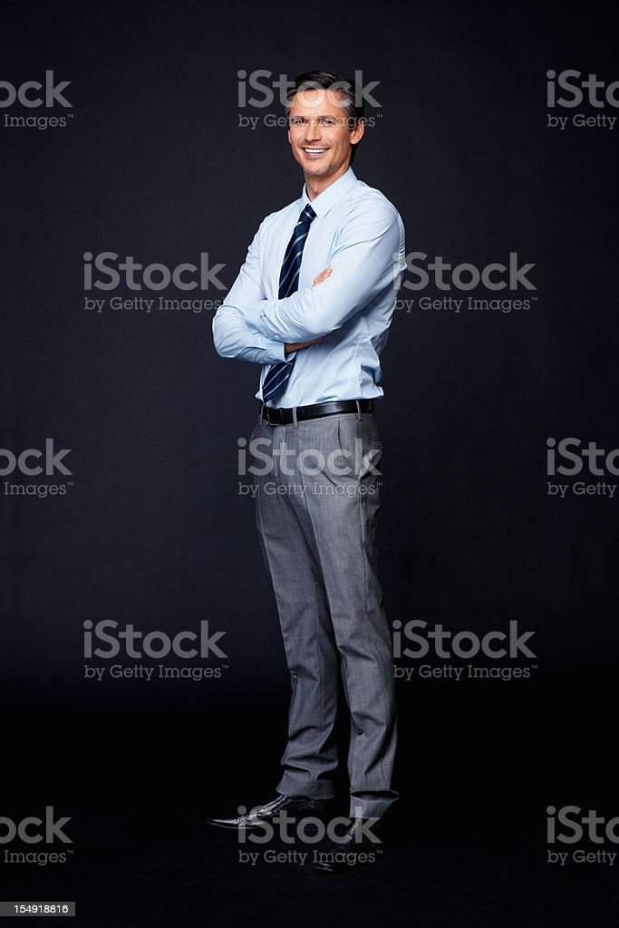Happy executive with arms folded royalty-free stock photo