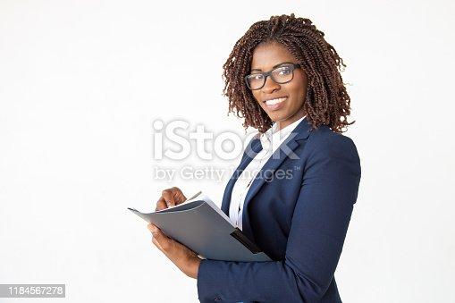 istock Happy expert checking documents 1184567278