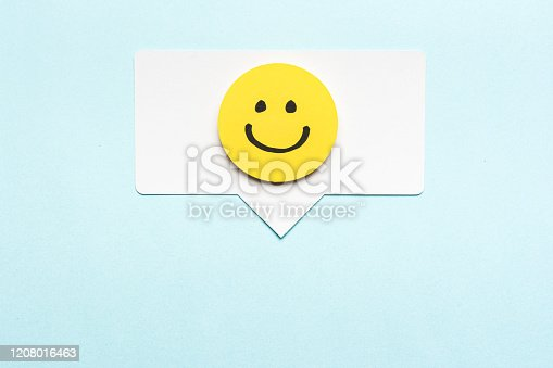istock Happy face emoticon smiling comment on speech bubble and blue background. Social media marketing concept. 1208016463