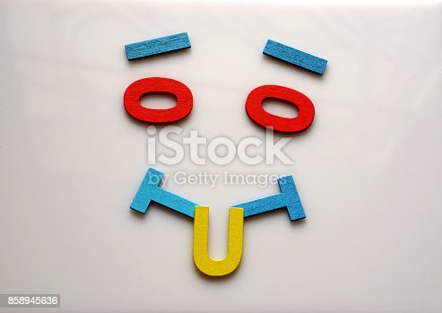 istock Happy face made from English alphabet letters  are lined on white background with empty space. 858945636
