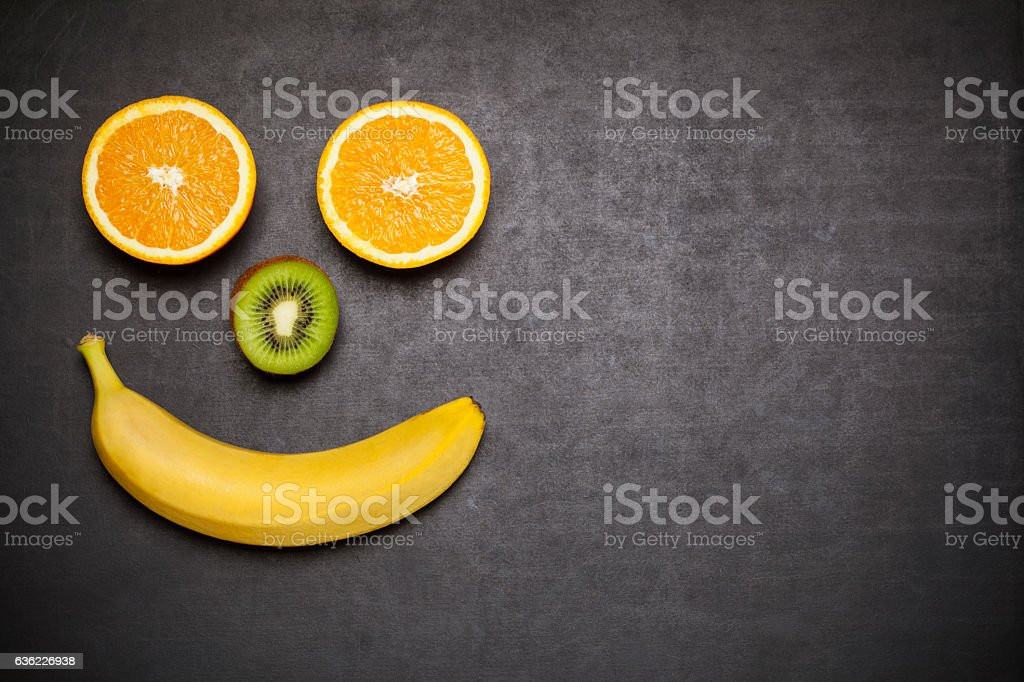 Happy face made with fresh fruits stock photo