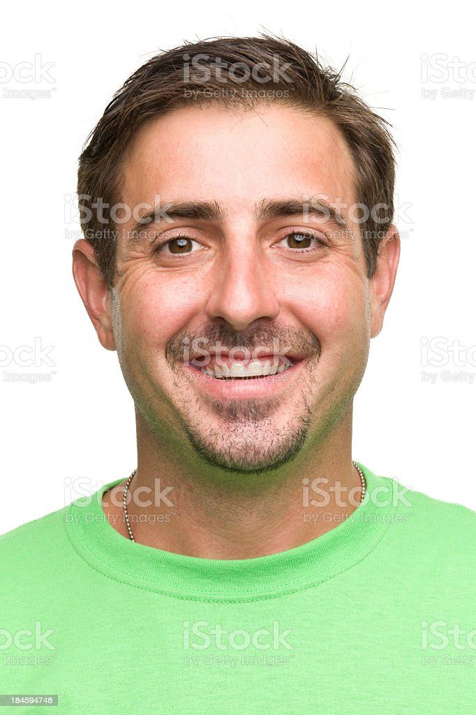 Happy face of a man with green shirt and brown hair smiling royalty-free stock photo