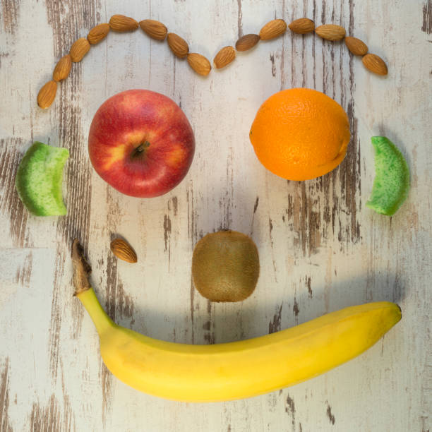 Happy face of fruits stock photo
