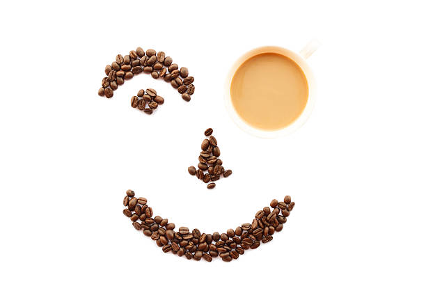 Happy Face Shaped Of Coffee Beans With Cup Stock Photo