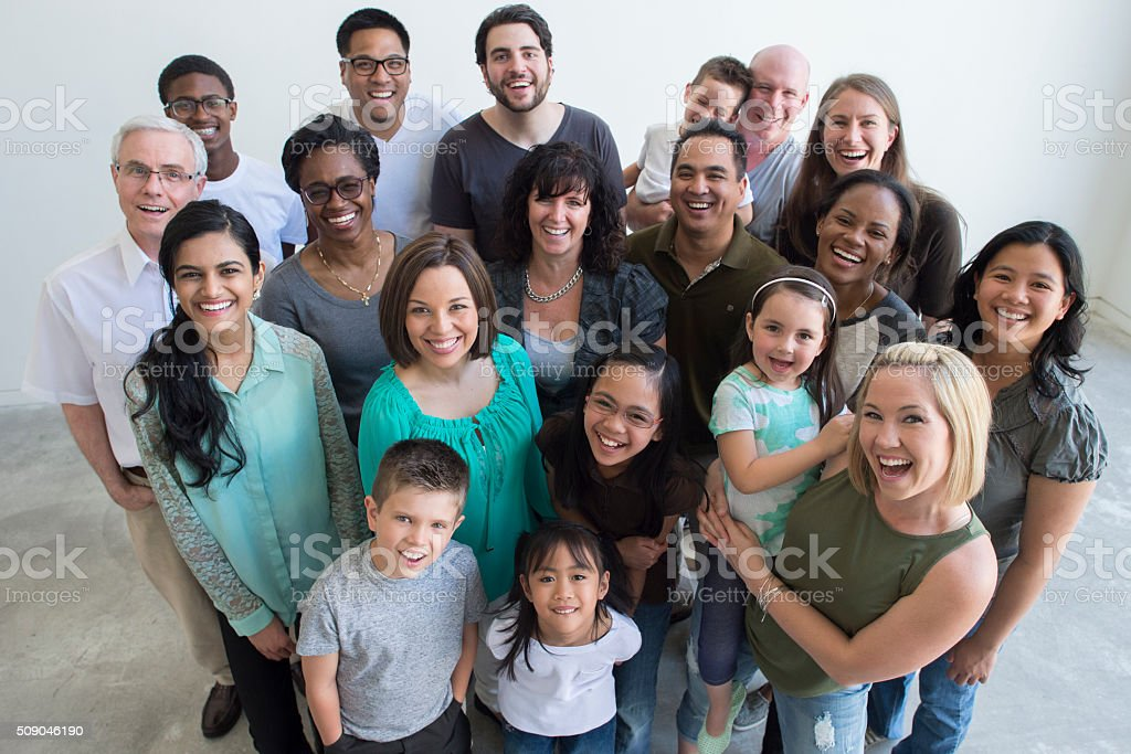 Happy Families Standing Together stock photo