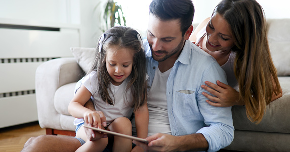871175856 istock photo Happy familiy spending fun time at home 887532200