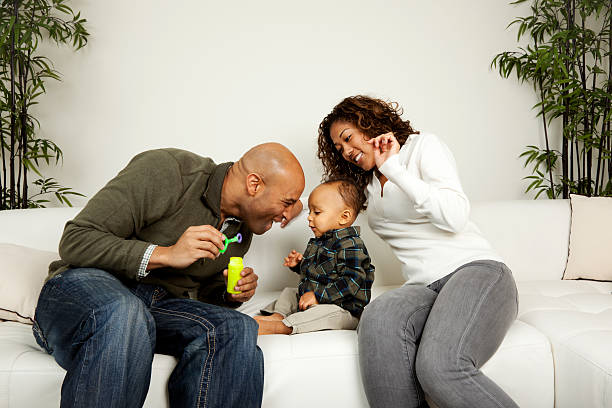 White Wife Black Baby Stock Photos, Pictures & Royalty