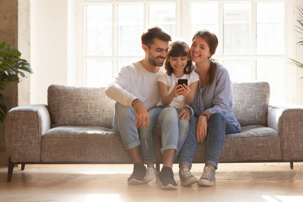 happy family and kid having fun with smartphone at home - video call imagens e fotografias de stock