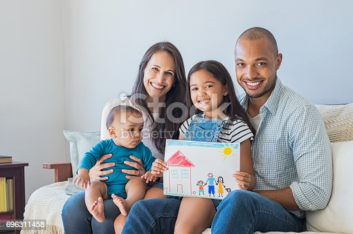 istock Happy family and new home 696311458