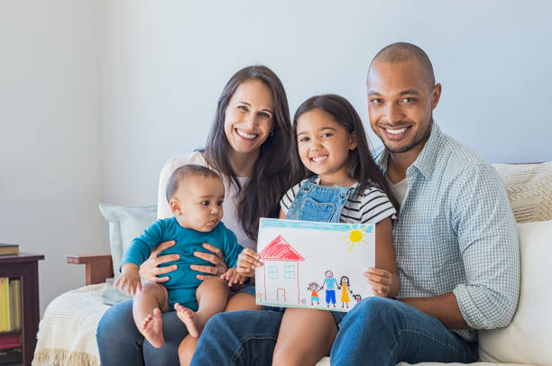 Happy family and new home stock photo