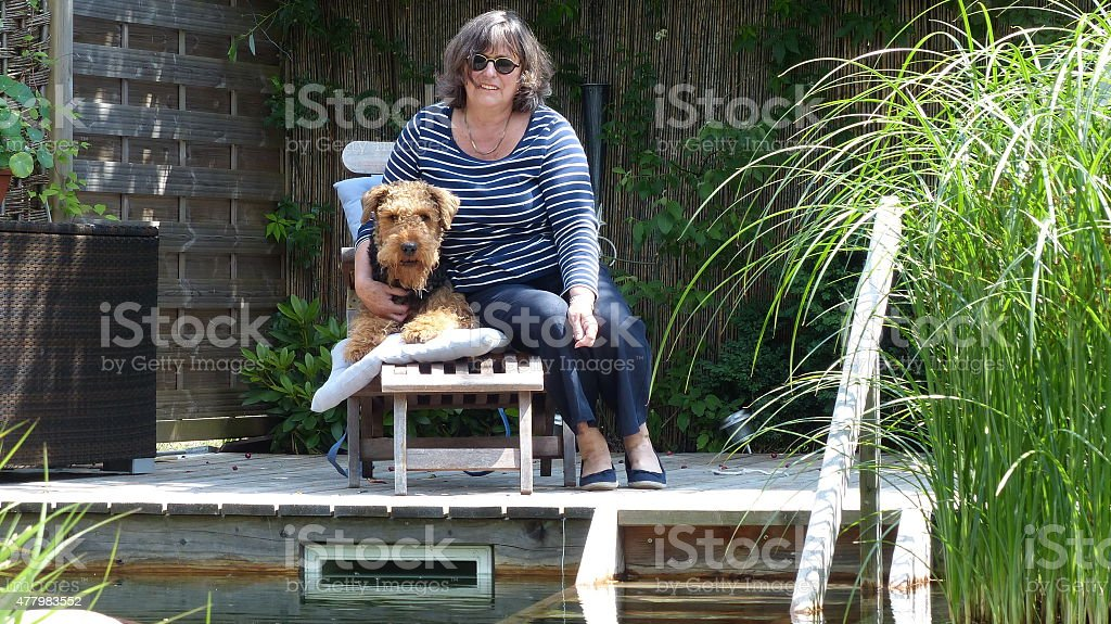 Happy family and the non swimmers Airedale Terrier stock photo