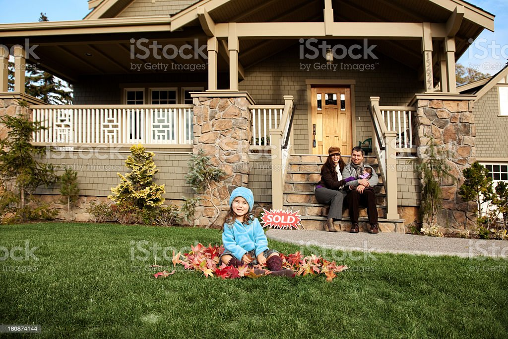 Happy Family and their new home stock photo