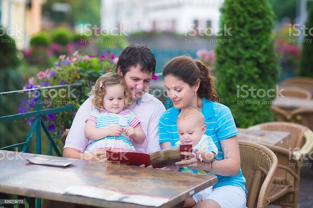 Happy family at an outside cafe stock photo