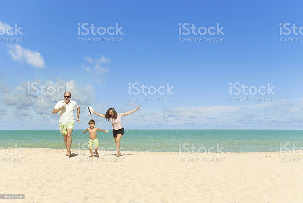 Happy family at beach vacation royalty-free stock photo