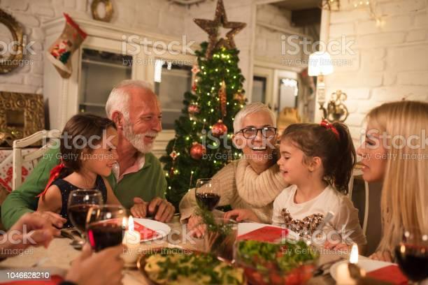 Happy family at christmas dinner party picture id1046628210?b=1&k=6&m=1046628210&s=612x612&h=fb9oyivwhkfp7watmbu6wlyqv2dchqjvdzyu y1osh4=